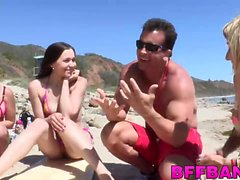 Teen babes love getting hammered by the lifeguards dick