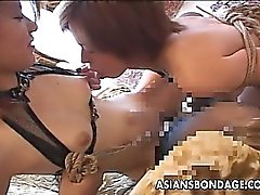 Asian lesbians in wax and rope bondage