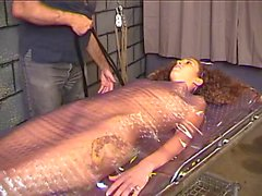 Horny brunette takes pain wrapped in plastic