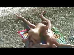 Steamed-up hubby touches his wife`s hairy cunt while sunbathing on the beach