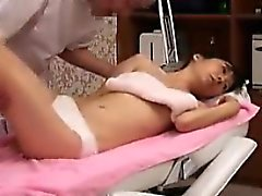 Japanese chick gets dressed for a sensual massage in her un