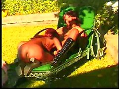 Redhead ebony chicks are outside on the lounge and eating pussy