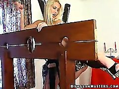 Tied up and masked slave Junkova gets anally punished by a