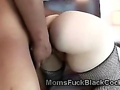Curvy cougar in sexy stockings gets pumped by black cock