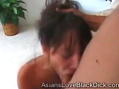 Slim Asian beauty gets her throat pounded with a huge dick