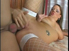 Big breasted housewife in fishnets fucks a hard stick in the kitchen