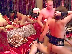 Several couples fuck hard in this huge swinger party