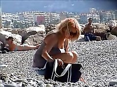 beautiful milf undressing on the beach