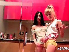Skinny Sasha dancing naked with her lesbo GF in the kitchen