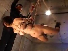 Kinky Oriental slut with big natural boobs gets tied up and