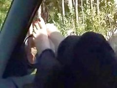 Hot blonde gives a sweet foot job with her sexy red toes in the car