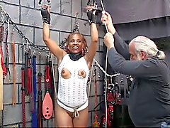 Cute young black bdsm babe gets restrained in Master Len's basement dungeon