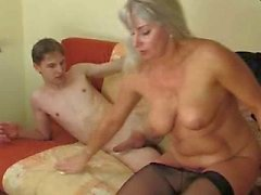 Young man enjoying a horny older woman