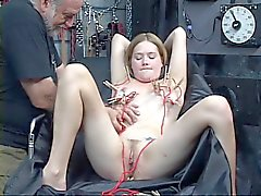 Cute bound girl has clothespins clipped all over her cunt in bondage dungeon