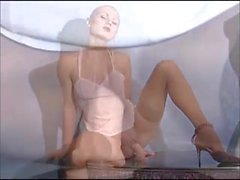 bald russian girl plays with toys