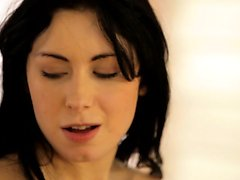 Raven haired coed Luna Ora enjoys an erotic massage that