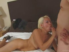 Amateur blonde takes two cocks at once