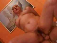 Hairy and chubby mature chick gets cum blasted by a young stud