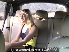 Blonde bangs in fake taxi after Halloween party
