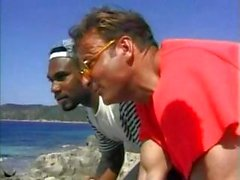 Two horny dudes find a hot brunette on the beach and have an interracial threesome