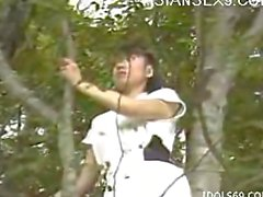 Asian fucking couple in a forest