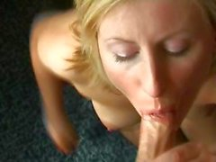 Sexy mature blonde Lara wears sexy black stockings and gives a POV blowjob