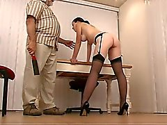 Cute slut with dark hair and nice tits in garter belt gets spanked hard