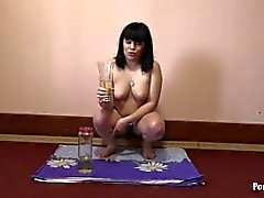 Russian girl with hairy by a pussy, pissing in the kitchen. Golden drink fo