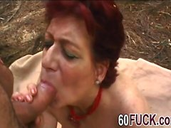 Slutty redhead granny big cock outdoor blowjob