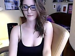 Attractive brunette geek with large breasts talks on liveca