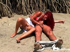 Redhead chick sucking cock and riding on beach