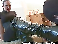 Horny mistress goes wild in her leather boots