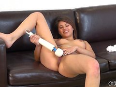 Shyla Jennings spreads her naked body across the couch and masturbates