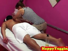 Busty asian tugging masseuse in sneakers