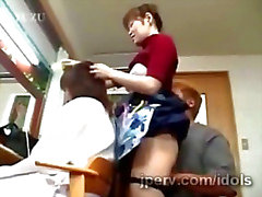 Mature Japanese hairdresser gets teased while working