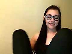 A cute brunette with glasses masturbating