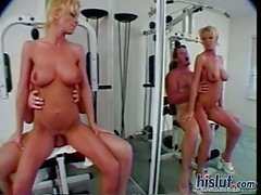 Tattooed milf fucked in gym