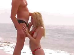 Hot beach sex with blonde eating his cock and then riding it