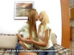 Alla and Jodi amateur blonde and redhead lesbian chicks kissing on the couch