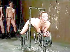 Girl Tied To Metal Frame In Doggy Getting Her Pussy And Mouth Fucked By Mistress With Strapon And Master In The Dungeon