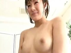 Flexible Asian beauty displays her superb curves and her sw