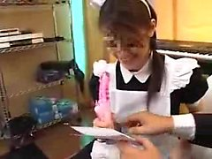 Provoking Japanese maid works her sweet lips on a hard cock