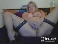 Chunky blonde in black stockings masturbates for her cam viewers