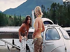 Michelle Rodriguez showing some cleavage in a bikini as she