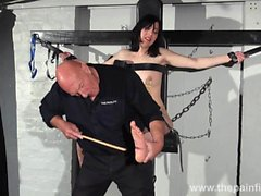 Feet whipping and bastinado of tied Honesty