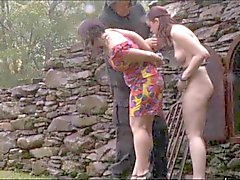 Outdoor BDSM Perverts Slaves in Chains in the Rain
