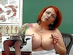 Big breasted redhead teacher toys her muff