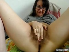 Brunette nerd with unshaved hairy bush uses dildo
