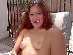Two sexy brunettes get hot and horny and rub their pussies outside