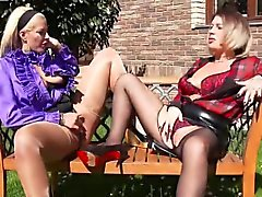 Glam lesbo licks outdoors